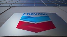 Openluchtsignage raad met het embleem van het Chevronbedrijf De moderne bureaubouw Het redactie 3D teruggeven Stock Foto's