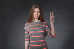 Openness, friendship concept. Woman showing victory sign Stock Images