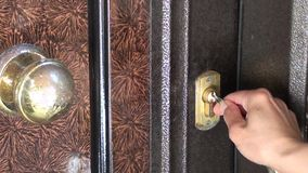 Openning a door lock with keys stock footage