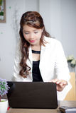 Openning laptop computer. Asian woman standing and look at laptop computer Stock Images