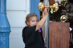 That opens the door of the hotel beautiful blonde blue-eyed girl Stock Photos