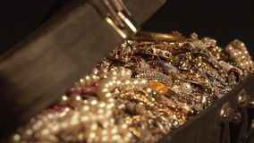 Opens an old suitcase with treasures. jewelry. secret treasure stock video footage