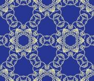 Openwork шнурок на синей предпосылке Стоковое Фото