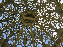 Openwork arch. Through a bizarre set of openwork arbor can see the sky and clouds Royalty Free Stock Photos