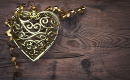Openwork carved golden heart Royalty Free Stock Images