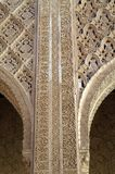 Stone carving in the Moorish castle. Openwork carving on a stone. Phrases in Arabic, carved on the wall. Medieval Moorish castle in Spanish Granada. A fragment Stock Photos