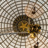 Openwork design of a dome made of glass and metal. royalty free stock photography
