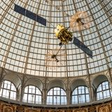 Openwork design of a dome made of glass and metal. Space satellite under the dome of the Soviet exhibition pavilion in Moscow. Russia Royalty Free Stock Image