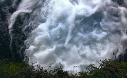 Openwork foam. Light elegant white foam under waterfall stock photography