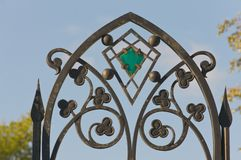 Openwork forged iron fence. With stained glass inserts Royalty Free Stock Photos