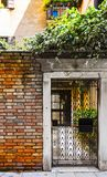 Openwork gate in Venice. Openwork gate of old house in Venice. Entrance to the home in the medieval italian town Stock Images