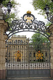 Openwork gate with the royal monogram in St. Petersburg, Russia Royalty Free Stock Images