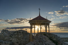 Openwork gazebo at sunset. And the ruins of Chersonesos Stock Images