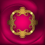 Openwork gold frame on pink fabric Stock Photography