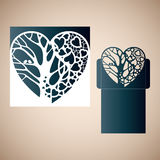 Openwork heart with a tree inside. Stock Image
