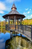 Openwork iron gazebo. Over the water is Stock Photo