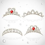 Openwork jewelry tiaras with diamonds and faceted red stones Royalty Free Stock Photos