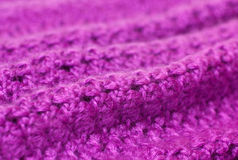 Openwork knitting of purple yarn Stock Image