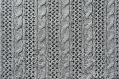 Openwork knitwear. Abstract openwork gray knitwear texture as a background Stock Images
