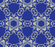 Openwork lace on a dark blue background Stock Photo