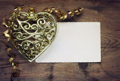 Openwork lace golden heart with ribbon Stock Image
