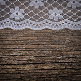 Openwork lace on wooden background royalty free stock photography