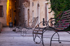 The openwork metal benches on the waterfront of the Senglea, Mal Royalty Free Stock Image