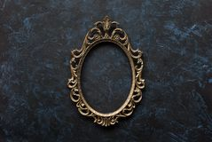 Metal oval frame. Openwork metal oval frame on a dark background Royalty Free Stock Photo