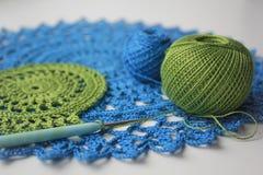 Openwork napkin. Ornamental lace pattern  on gray background Stock Image