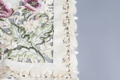 Openwork napkin tablecloth. On a gray background Royalty Free Stock Photo