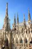 Openwork pinnacles at Milan Cathedral in Italy Stock Photos