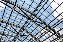 Openwork steel and glass ceiling. In shopping center stock photos