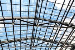 Openwork steel and glass ceiling. In shopping center royalty free stock photography