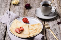 Openwork thin cheese crepes served with strawberry stock images