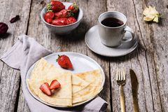 Openwork thin cheese crepes served with strawberry stock photos