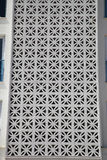 Openwork ventilation grille in oriental style. Detail of the house Stock Photos