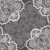 Openwork white pattern seamless. Gray background  handmade Royalty Free Stock Photos