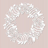 Openwork wreath with flowers and painted Easter eggs. Stock Images