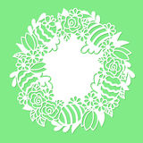 Openwork wreath with flowers and painted Easter eggs. Royalty Free Stock Images