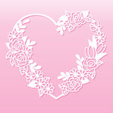 Openwork wreath of flowers in the shape of a heart. Laser cutting template. Stock Photo
