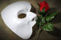 Opera. Photo of White Mask and a Fabric Rose - Opera Concept royalty free stock image