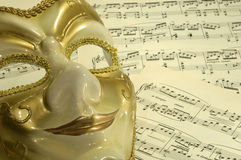 Opera. Photo of a Mask on Sheetmusic - Opera / Theater Concept stock photography