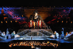 The opera Aida. Aida evening debut at the Arena di Verona in July 2010. In the bottom is visible also the orchestral group stock photos