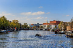 Opera and balet in Amsterdam with boats on the canal Stock Photography