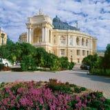Opera Theatre in Odessa, Ukraine. Opera and ballet theatre in Odessa, Ukraine with red flowers at front stock photo