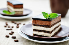 Opera cake. On a light brown background. tinting. selective focus stock images