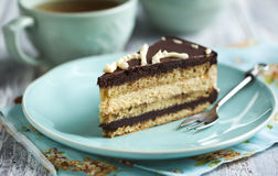 Opera cake. Piece of Opera cake and cup of tea stock images