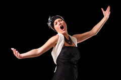 Opera diva. A picture of a young beautiful opera singer performing over black background royalty free stock photos