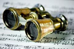 Opera glasses. A pair of opera glasses on sheet music stock photo