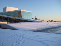 Opera-house. Norway's new operahouse is built of marble and glass. The building is situated by the sea. The roofs are open for everyone to walk on royalty free stock photos